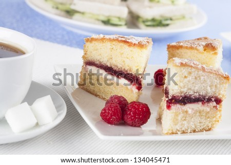 Victoria sponge cake with raspberries for afternoon tea.