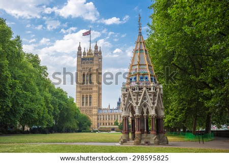Victoria Tower (Houses of Parliament) and Buxton Memorial Fountain shot from Victoria Tower Gardens, London, UK
