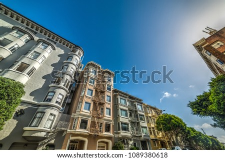 Victorian buildings under a clear sky in San Francisco. California, USA #1089380618