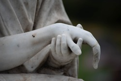 Victorian cemetery pieta statue hands of Jesus and Mary in white stone. Full frame, shot in natural light with copy space.