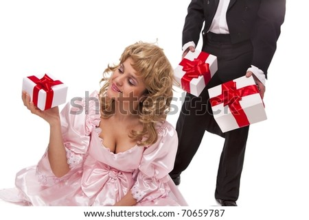 Victorian couple with gift boxes. Isolated over white background - stock photo