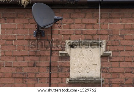 Victorian date mark on house with TV satellite dish