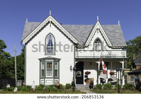 Victorian house with a gingerbread roof decoration