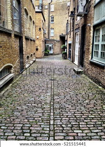Victorian industrial architecture, London. A cobbled back street in an old industrial district in East London with period architecture and features. #521515441
