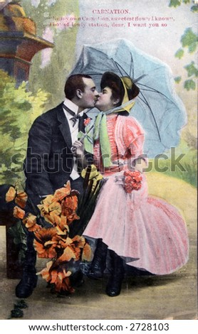 Victorian romance - couple kissing under umbrella  - circa 1904 vintage hand-tinted photograph