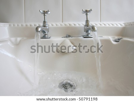 Victorian-style bathroom taps with running water