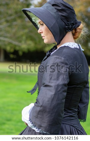 Victorian woman in black dress and bonnet