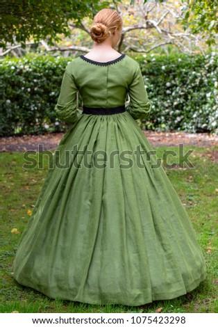 Victorian woman in green dress