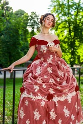 Victorian woman 19th century posing in red dress