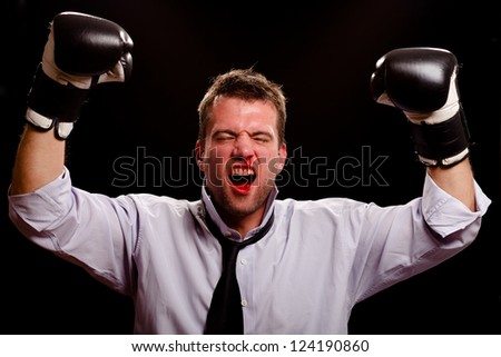 Victorious boxing businessman with blood pouring out of his nose and mouth