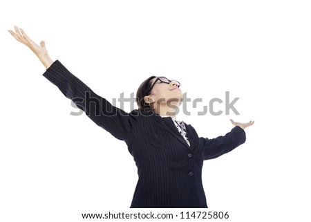 Victorious businesswoman stretching her arms because of her accomplishments