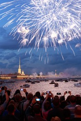 Victory day firework in front of Peter and Paul fortress in Saint-Petersburg, Russia, huge crowd and boats