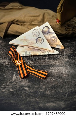 Victory Day holiday concept. military orders, ribbon of St. George, war letter - traditional symbol of 9 may, Victory Day 1945.