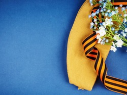 Victory Day Still Life, background for postcards by may 9, victory day: cap, letters, and St. George ribbon