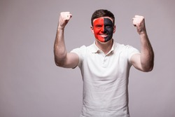Victory, happy and  goal scream emotions of Albanian football fan in game support of Albania national team on grey background. European 2016 football fans concept.