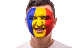 Victory, happy and  goal scream emotions of Romanian football fan in game support of  Romania national team on grey background. European 2016 football fans concept.
