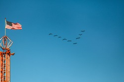 Victory on the sky with american flag and birds