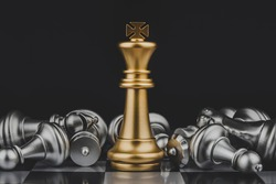 Victory. shot of golden king stand with silver chess pieces on chess board game competition with dark background, chess battle, victory, success, team leader, teamwork, business strategy concept
