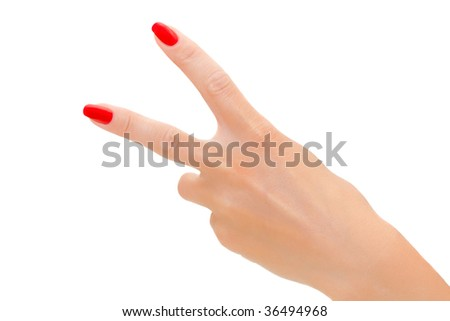 Victory sign. Elegant woman's hand with red nail polish - stock photo
