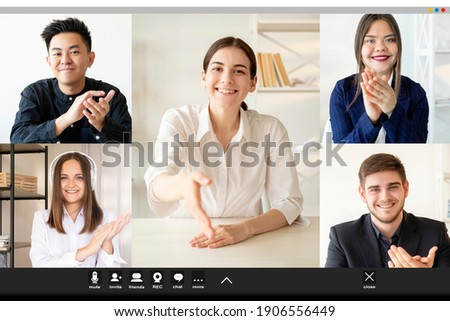 Video call. Online meeting. Group teleconference. Remote work. Screenshot of cheerful diverse multiethnic corporate team applauding greeting female colleague offering handshake at virtual office.