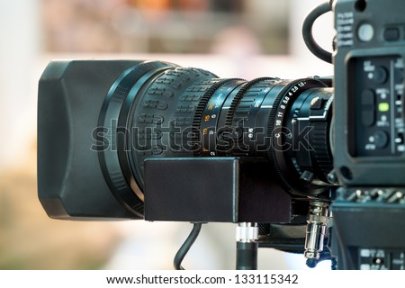 Video camera lens - recording show in TV studio - focus on camera aperture