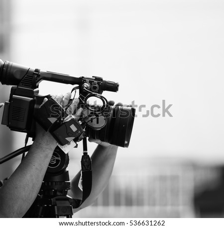 Video camera operator working with his professional equipment #536631262