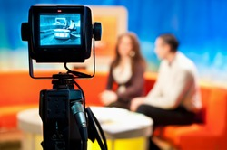 Video camera viewfinder - recording show in TV studio - focus on camera