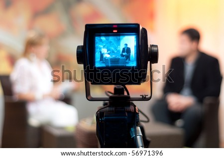 Video camera viewfinder recording show in TV studio focus on camera