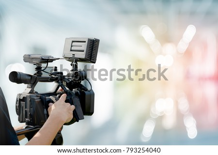 Video camera with abstract blurred background, idea concept for video professional business.