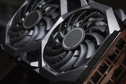 video card with two coolers on dark background. concept computer harware