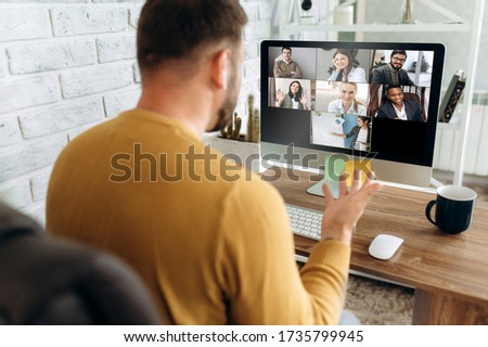 Video conference. Business partners communicate via video conference using computer. The guy talks with his business partners appearance about plans and strategy. Distant work