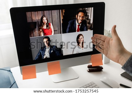 Video conference. Business partners communicate via video using laptop.