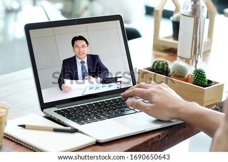 Video conference, Work frome home, Businessman making video call to employee with virtual web, Contacting manager by conference on laptop computer at home, Talking on webcam, Online consultation, HR