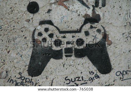 Video game controller painted on a wall.