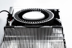 Video Graphics card with powerful GPU isolated on white background, uncovered cooler and fan