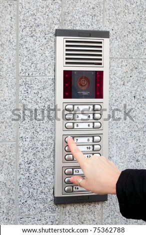 Video intercom in the entry of a house and secret guest, technology and security background