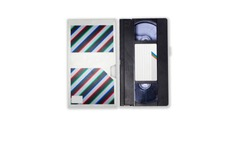 Video tapes with labels and covers. Front view and side view