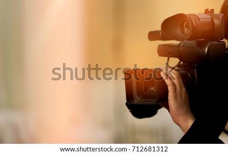 videographer close up / cameraman / movie / professional camera / man with camera