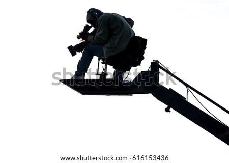 Videographer use Video camera to shoot an event. #616153436