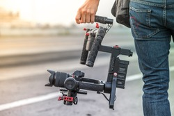 Videographer with gimbal video camera dslr, Professional video equipment, Videographer in event film production shoot video.