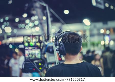 Videographers are controlling camera crane.