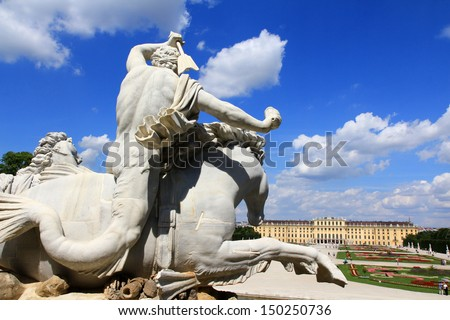 VIENNA - AUGUST 2012 : Statue of Neptunes entourage - a Triton creature (half-man, half-fish) rides a horse above the Neptune Fountain at Schloss Schoenbrunn Palace on August 9, 2012.