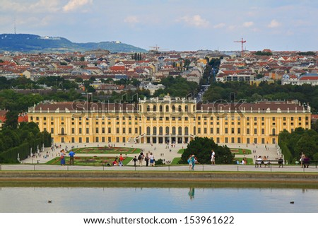 VIENNA, AUSTRIA - AUGUST 2012 : Schloss Schoenbrunn Palace, view from the reflective pond at Gloriette with Vienna city in background on August 9, 2012.  One of popular tourist attractions in Austria