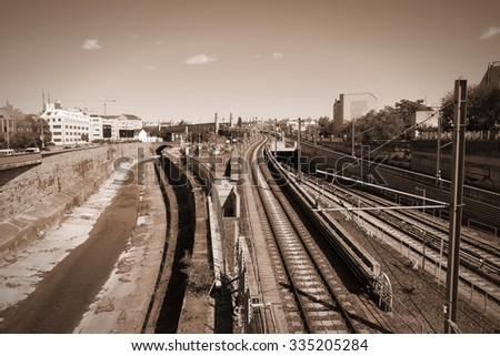 Vienna, Austria - cityscape with Danube canal and railway tracks. Sepia vintage style photo.