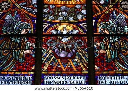 Vienna, Austria - colorful stained glass in Votivkirche (Votive Church). Holy Spirit depicted as a dove.