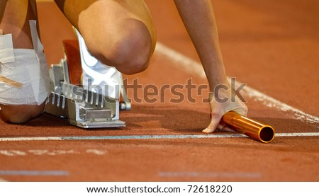 VIENNA, AUSTRIA - FEBRUARY 19: Indoor track and field championship.  Relay runner in the starting blocks at an indoor track and field event on February 19, 2011 in Vienna, Austria - stock photo