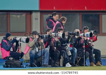 VIENNA, AUSTRIA - FEBRUARY 18 Photographers on the sideline during the soccer game on February 18, 2012 in Vienna, Austria. The game between Rapid and Austria ends 0:0.