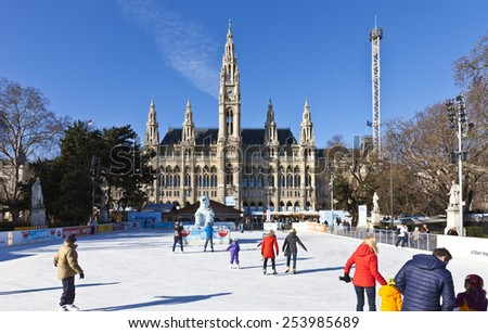 VIENNA, AUSTRIA - JANUARY 31, 2015: Ice skating people at the Wiener Eistraum (ice rink). The town government establishes every winter an ice rink in front of the Viennese city hall.