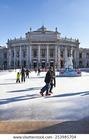 VIENNA, AUSTRIA - JANUARY 31, 2015:  Ice skating people at the Wiener Eistraum - is a mobile ice rink, which is built since 1996 every year between the City hall of Vienna and the Burgtheater.