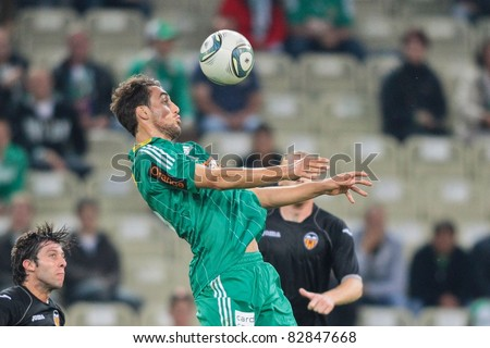 VIENNA,  AUSTRIA - JULY 26: Atdhe Nuhiu (#15, Rapid) heads the ball during the friendly soccer game on July 26, 2011 in Vienna, Austria. SK Rapid wins 4:1.